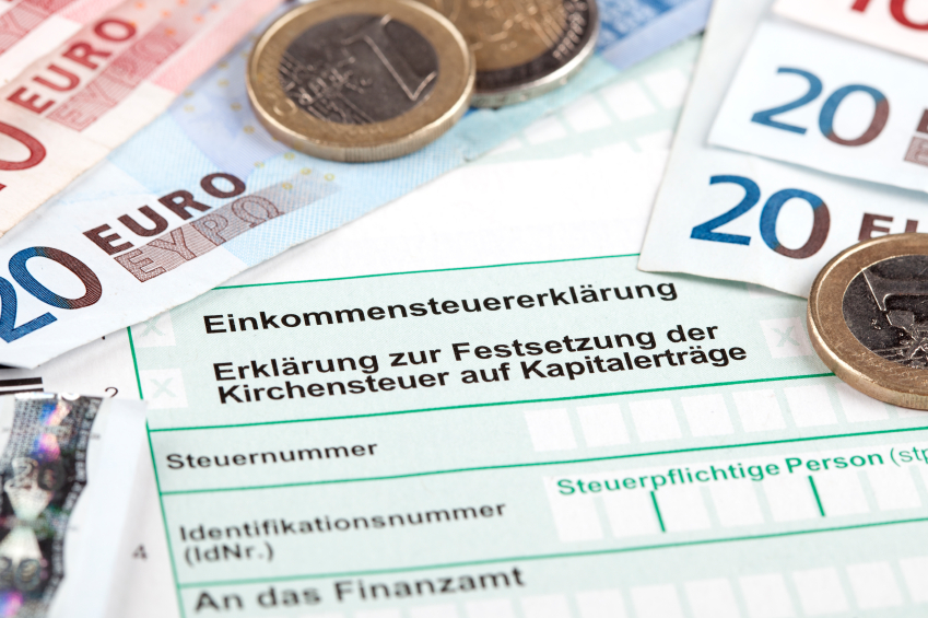 German Tax Form with Euro banknotes and coins